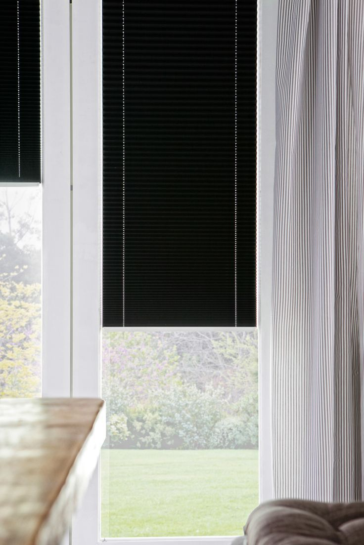 Black Intu Micro blinds sit within the door frame of bi-fold doors.