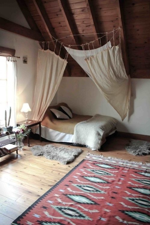 Dreamy boho chic bedroom. Love the kilm rug, exposed timber beams & fur.