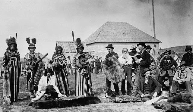 Mistahimaskwa (Big Bear) (4th from left), a Plains Cree chief, trading fur at Fort Pitt, N.W.T., 1884 / Mistahimaskwa (Gros Ours) (4e à partir de la gauche), chef cri des Plaines, faisant la traite de fourrures à Fort Pitt, T.N-O., 1884 | by BiblioArchives / LibraryArchives