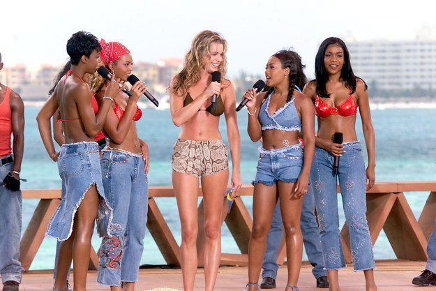 Farrah Franklin trying to get her five seconds of airtime talking to Rebecca Romijn-Stamos at MTV's Spring Break covered in denim while Beyoncé just stares like… | 60 Pictures That Perfectly Capture The 2000s