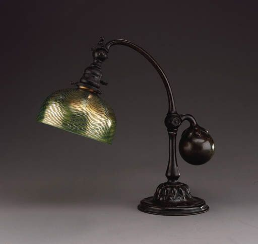A FAVRILE GLASS AND BRONZE COUNTER BALANCE DESK LAMP Tiffany Studios 15in.  (40cm.