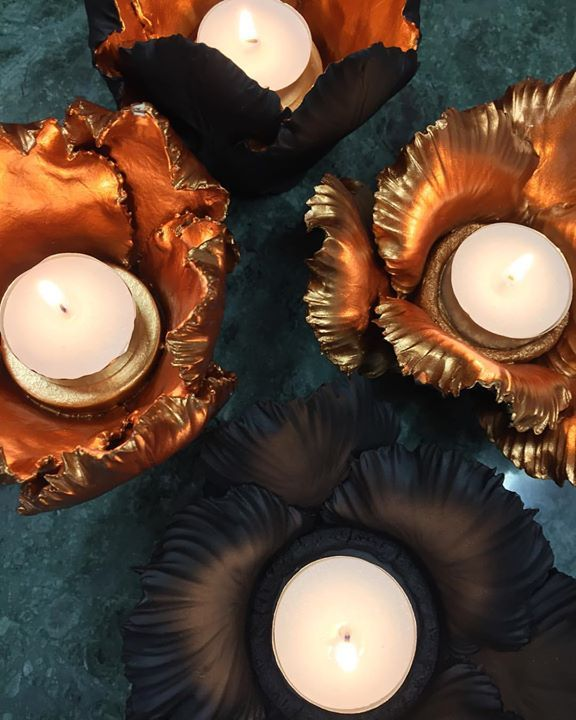 Our favourite Daffodil & Leaf candle holders by Kiddee Tamdee are now available in a stunning copper finish. Stunning at night.  #handmade  #copper #marble #luxe
