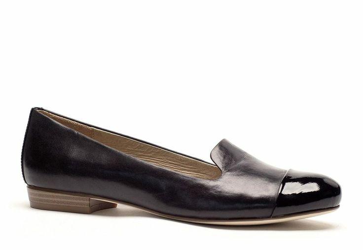 Slim black slip-on with patent toe cap.