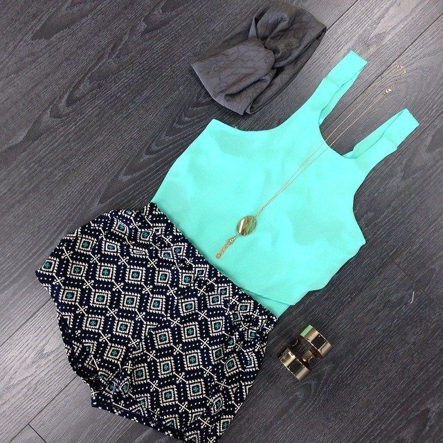 Cute summer outfit! Neon bluish green tank with soft patterned shorts and accessories