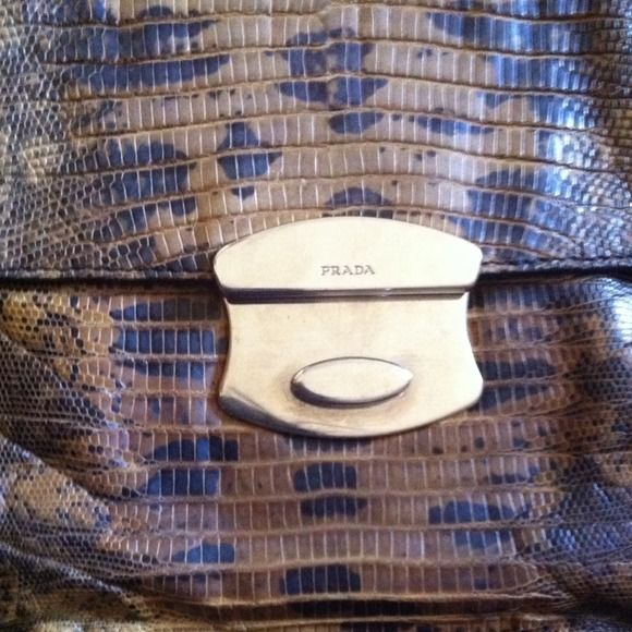 % Authentic vintage Prada clutch reduced  Real alligator skin Prada clutch good condition with removable chain. Has a little damage on the bottom of the purse Prada Bags Clutches & Wristlets