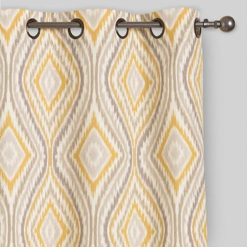 Our curtains feature a soft yellow and gray ikat ogee pattern. With metal grommets in an antique bronze finish, they add a splash of sophisticated global style to your windows.