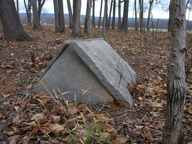 Tent graves. Found in Kentucky, Tennessee, Alabama and Arkansas. Design is intended as protection from animals such as cattle walking on the graves or to protect the grave from the weather
