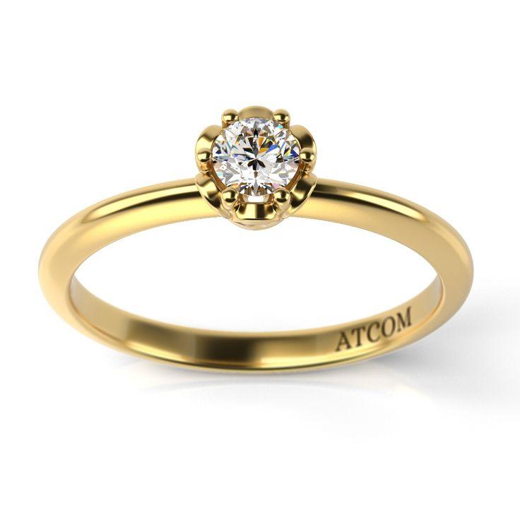 Beneficiind de o executie impecabila si o montura perfecta a diamantului dispus central, acest inel de logodna din aur galben 14K transmite o eleganta desavarsita.