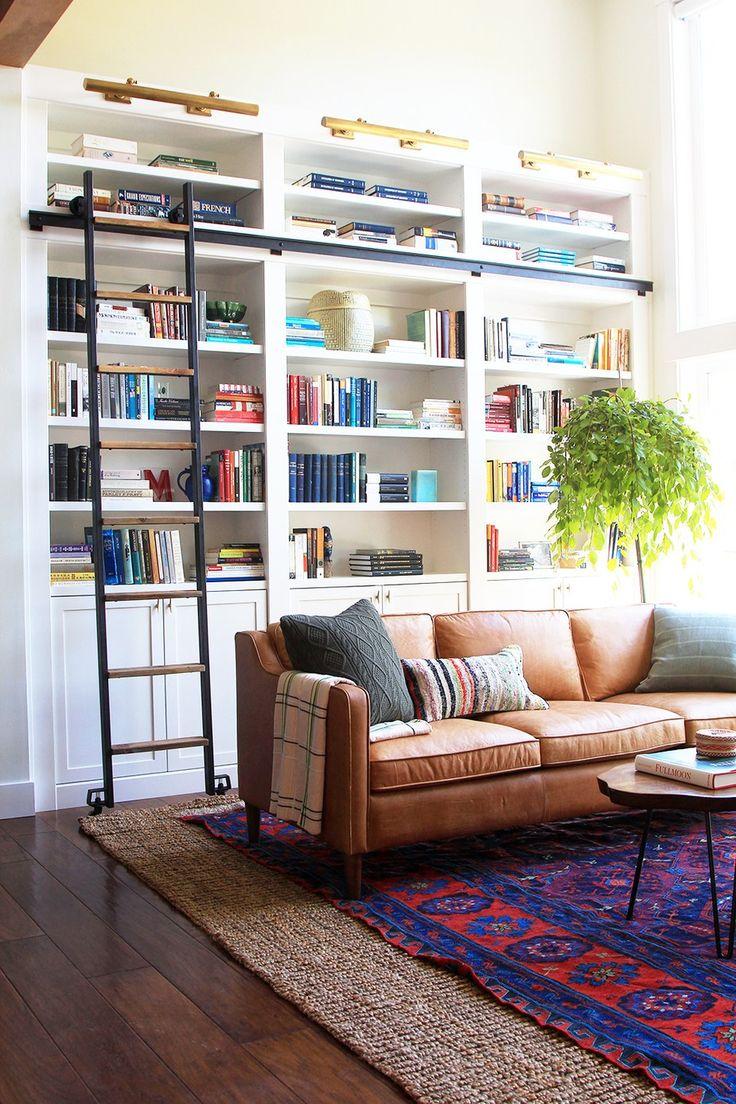 Black leather living room furniture - Designer Jenny Komenda S Living Room Where A Statement Rug Inspired The Rest Of The Room S
