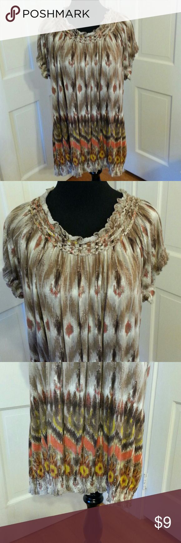 LADIES TOP TRIBAL PATTERN 2X BEAUTIFUL TRIBAL PATTERN LADIES TOP DESIGNED BY MADISON WOMAN 2X. ELASTIC FRONT AND BACK BOAT NECKLINE WITH FLUTTER SHORT SLEEVES.   THE BOTTOM IS A WIDE ELASTIC BAND THAT CAN BE WORN AT THE WAIST OR OVER THE HIPS. GENTLY WORN. Madison Tops Tunics