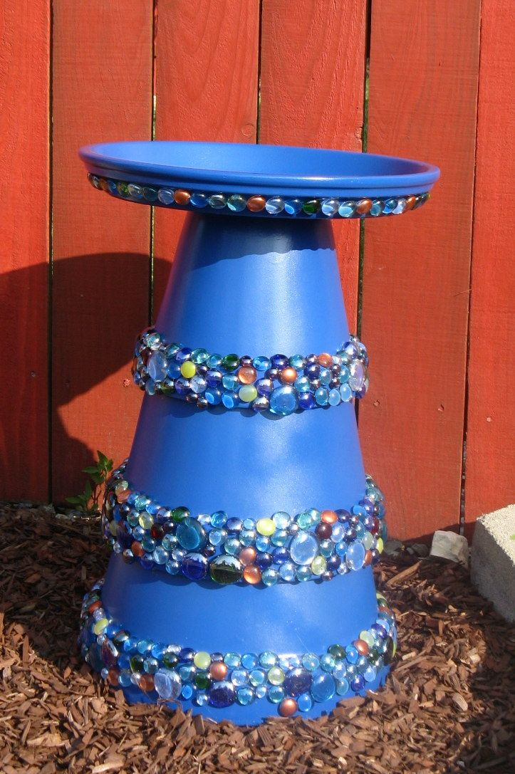 """Bird Bath that is easy to make and fun. use a 10"""", 12"""" and 14"""" terra cota pot. Paint them, glue together with caulk and decorate. Add a 16"""" terra cota pot base as the top, paint and caulk onto the base."""