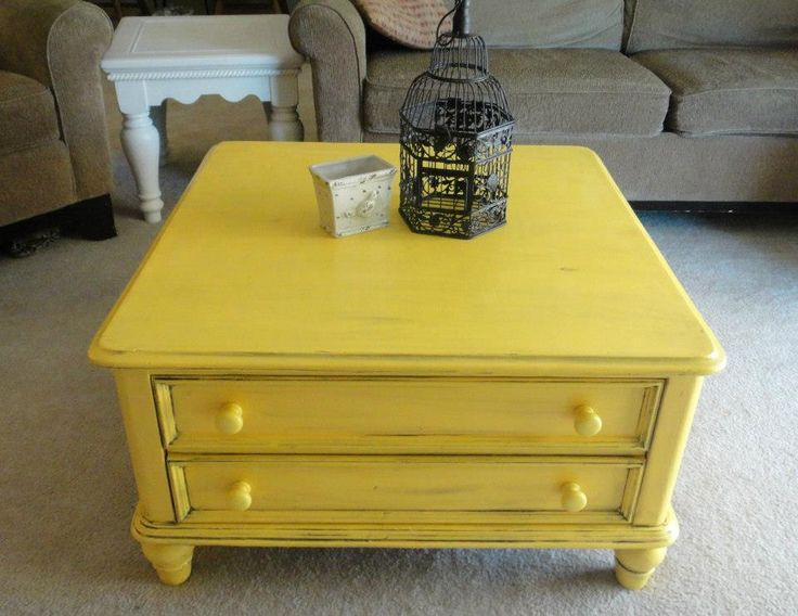 Sun Flower Yellow Coffee Table Redo with black glaze distressing. I love it as an accent piece