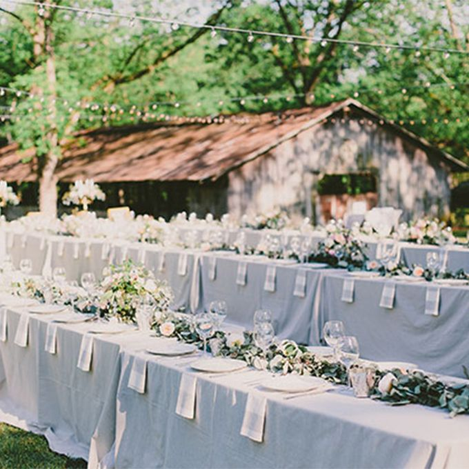 Long banquet reception table with slate tablecloth for Wedding reception table linen ideas
