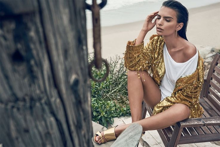 Emily Ratajkowski poses on the beach for the editorial