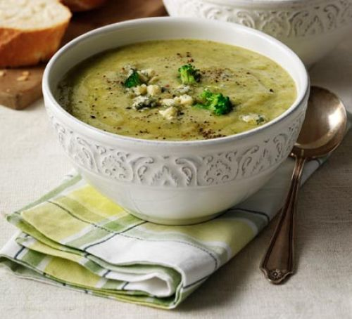"""Broccoli & stilton soup """"Dinner party tip: reserve uncooked broccoli florets, blanch in boiling water for 1 minute. Serve the soup in bowls, scattered with crumbled cheese and broccoli for a stylish garnish."""""""