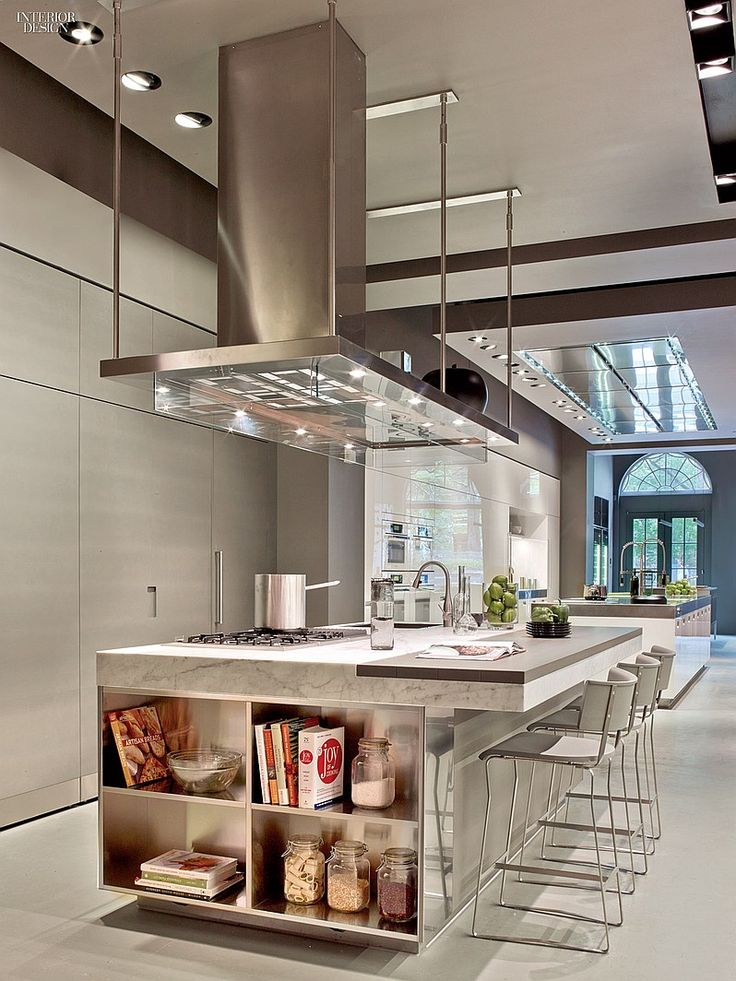 A Taste of Italy: Arclinea's New York Flagship | This stainless hood integrates LED fixtures. #design #interiordesign #interiordesignmagazine #architecture #kitchen #decor @arclinea