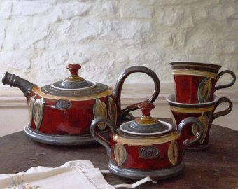 Red Ceramic Set With Hand Painted Decoration  PLEASE CHOOSE A VARIATION FROM THE DROPPING MENU BELOW THE TITLE  Measuring: - For the teapot: Capacity - 1000 ml/34 oz Approximate measuring 5.4in/14cm high (to the upper end of the lid) by 6.9in/18cm wide.  -For the sugar bowl: 5.1in/13cm wide (without the handles) by 3.5in/9cm high.  - For the large cups: Capacity - 200ml/6.7oz. 3.9in/10cm wide (without the handle) by 4.7in/12cm high.  - For the small cup...