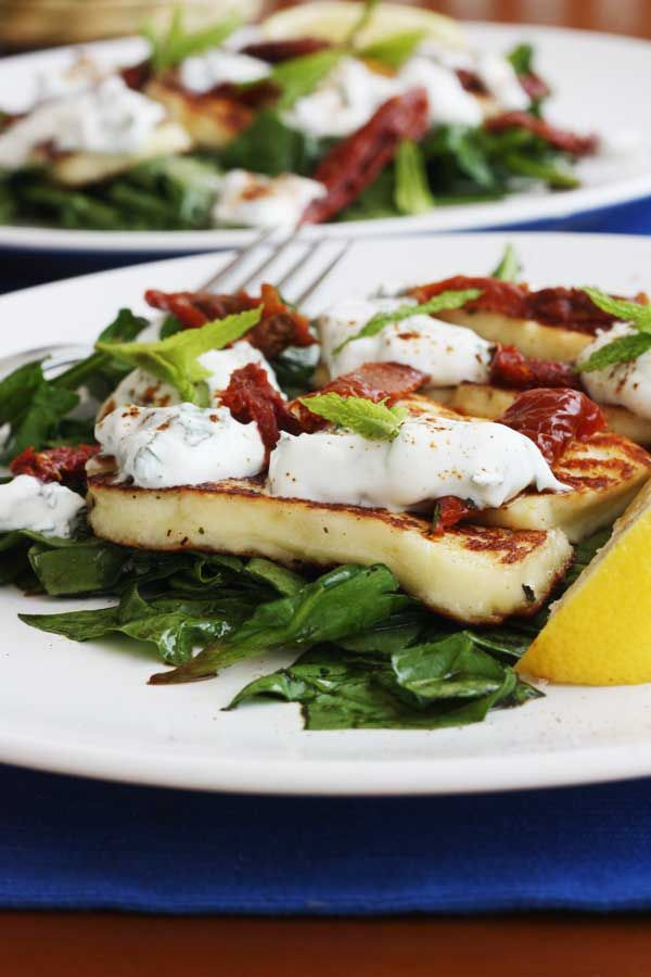 A vegetarian salad of crispy halloumi on a bed of spinach dressed in honey & balsamic vinegar. Dotted with sundried tomatoes and a minty lemony yoghurt.