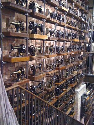 Wall of sewing machines! at All Saints clothing stores.  I have been to the one in Cardiff and it is amazing.  There are hundreds of old sewing machines lining the walls and the store-front windows.