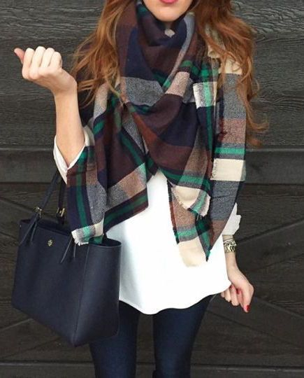 Match your black skinny jeans with a basic white tee, and layer on a green plaid scarf for extra texture and color!