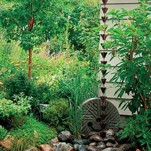 This Is A Rain Chain Garden! I Would Love To Have A Rain Chain Off The Side  Of My Porch
