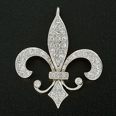 A platinum and diamond pendant, c.1910, in the form of a fleur-de-lys, symbol of France.  (A Brandt + Son)
