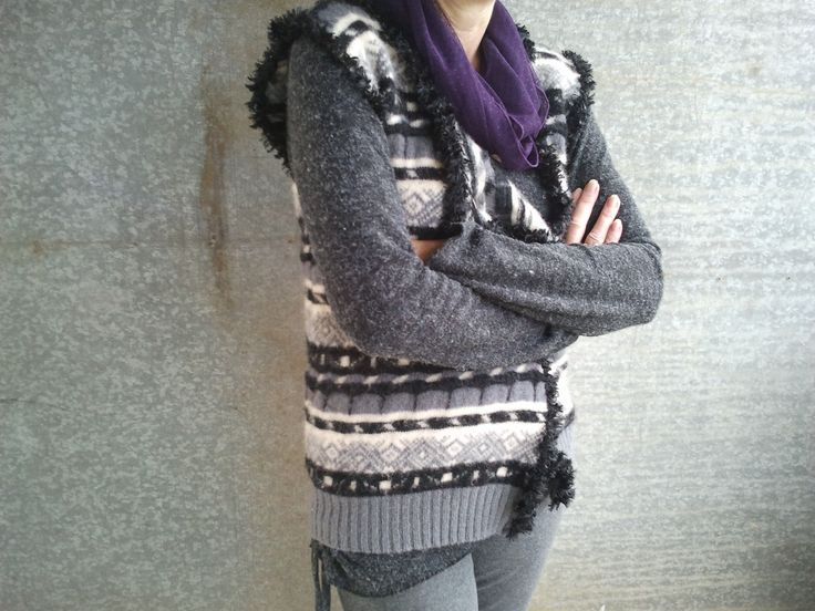 Man's jumper REscued from landfill and upcycled into a woman's open front vest.