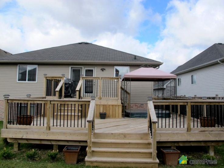 Deck design raised bungalow for Front deck designs bungalow