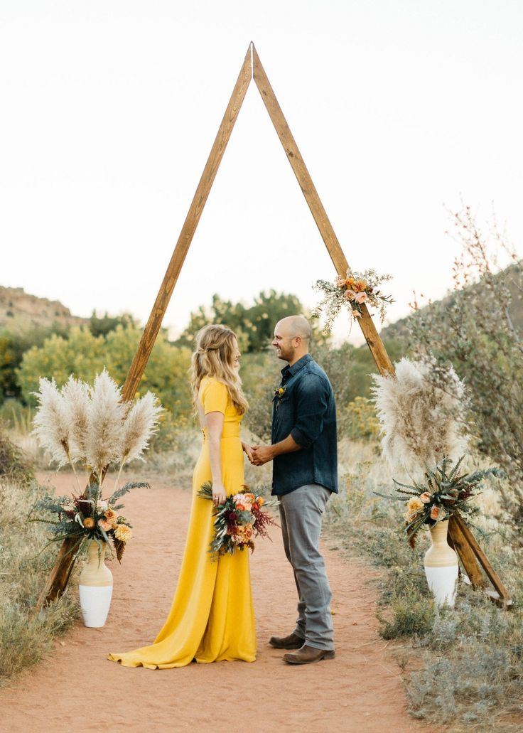 After sending postcard invites to friends and family while on a road trip, Amanda and Mark eloped at Red Rocks in Morrison, Colorado, in late September 2016. The bride's golden-yellow gown, designed by Sarah Seven, paid homage to the spectacular landscape and glorious sunset of their desert vows.