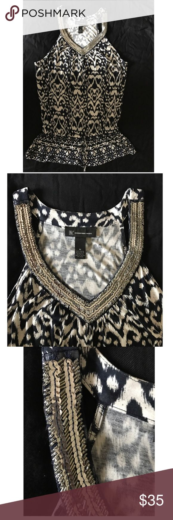 Inc blue and white short sleeve blouse Beautiful blue and white short sleeve top with silver sequins V Neck . Size M , 100% Rayon. Gathers at hips with tie, sits low at hips. INC International Concepts Tops Blouses