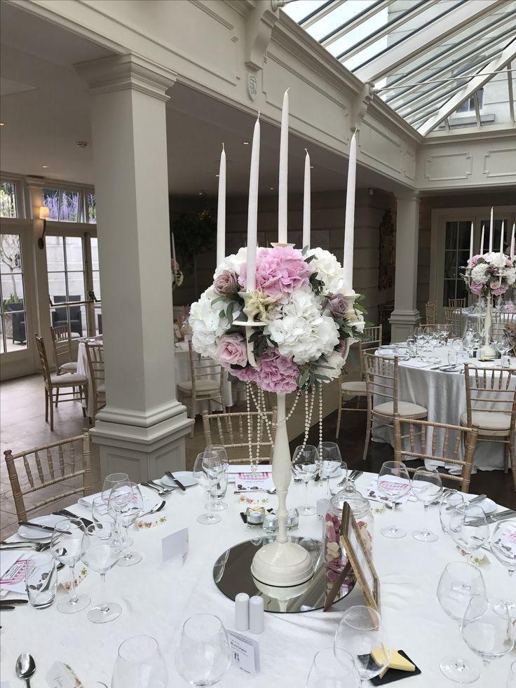 White Dress Candelabra: White Hydrangea, Pink Hydrangea, White Astilby, Olive Leaf, Eucalyptus, Sweet Avalanche, Soft Pink O'Hara