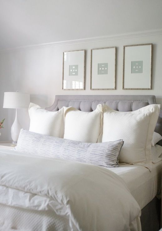 Collins Interiors - bedrooms - serene bedroom, white and gray bedroom, gray headboard, gray tufted headboard, art over bed, art over headboa...