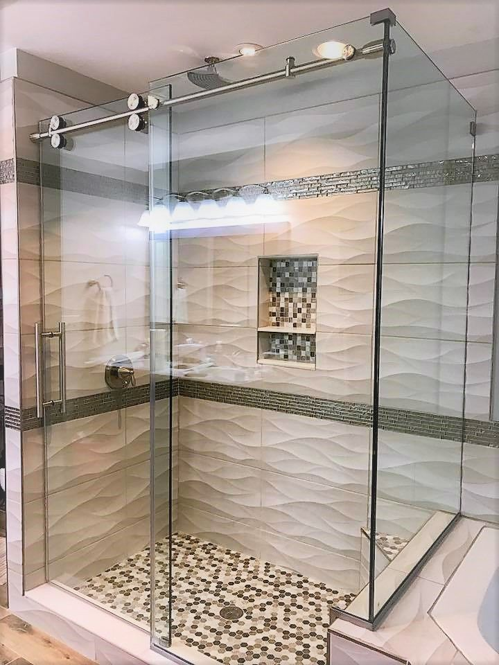 Barndoor Style Shower Door With A 90 Degree Return Panel Featuring 3 8 Glass And Stainless Steel Hardware Shower Doors Glass Shower Glass Shower Enclosures