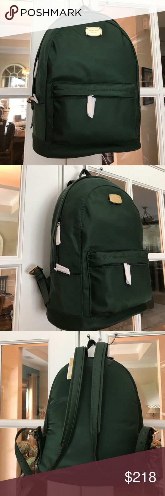 """Michael Kors Green Backpack JUST IN‼️-  Large green Michael Kors Backpack has gold colored trimming.  (Color is """"moss."""")    """"Michael Kors"""" is engraved on the name plate, zippers and the buckles.  Interior is fully lined with beautiful Michael Kors fabric and has many pockets on both sides of the interior compartment.  One zips.  There is also a front zippered pocket.  Roughly 11.5"""" x 15"""" x 6.""""  💕  (There are little scratches on the nameplate, but not significant. You have to look for them…"""