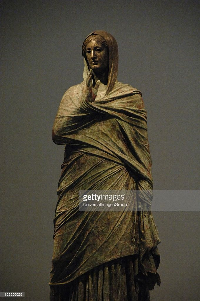 Greek Art, The lady of Kalymnos, Bronze statue, Found by a fisherman on the Sea of ​​Kalymnos in late 1994, Probably belongs to the Hellenistic Period, perhaps late 2nd century B.C, National Archaeological Museum, Athens, Greece.