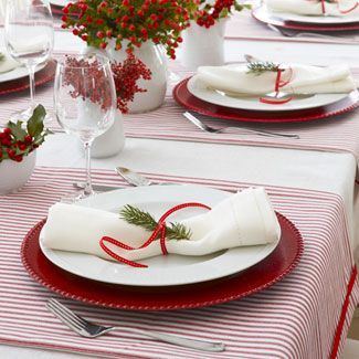 Striped runners, made in minutes from ticking fabric, set the scheme for this color-coordinated table. Rudolph-red ribbons, chargers, and winter berries continue the harmonious hues. Read more: Red and White Christmas Decorations - Red Christmas Decorating Ideas - Good Housekeeping