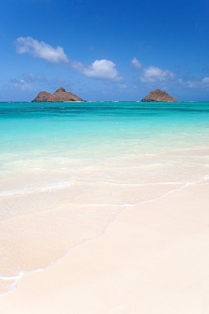 Mokulua islands and tropical sandy beach in Lanikai, Oahu, Hawaii - consistently ranked among the best beaches in the world.