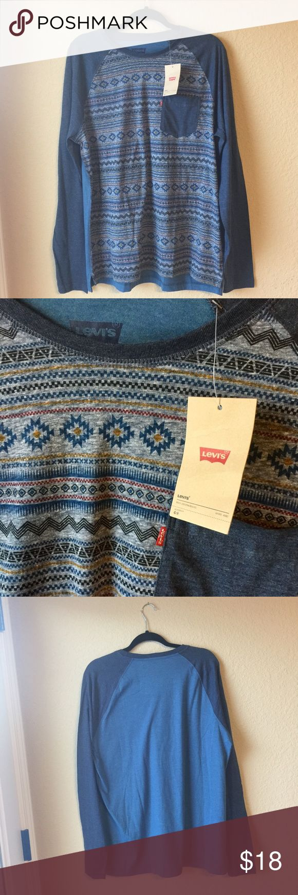 Levi's Crew Neck T-Shirt Levi's Long Sleeve Crew Neck Tee. Size Large. New with tags. Shades of denim blue, with Aztec print on front. Offers welcome! 🙂  Long sleeve  Crew Neck Chest pocket 60% Cotton, 40% Polyester Raglan Sleeve Levi's Shirts Tees - Long Sleeve