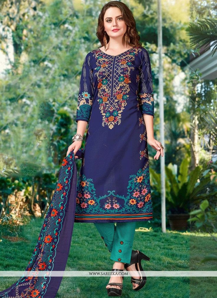 Appear stunningly appealing in such a green and navy blue cotton   churidar suit. You are able to see some fascinating patterns performed with print work. Comes with matching bottom and dupatta. (Slig...