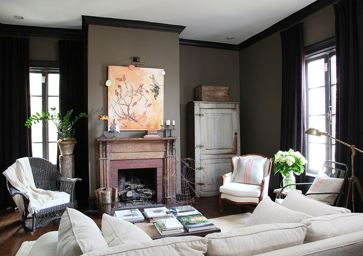 The Black Woodwork With Rustic Natural Wood Mantle And Furniture Is A Classy Take On Chic Decor I Love Wall Color It Would Be Perfect For