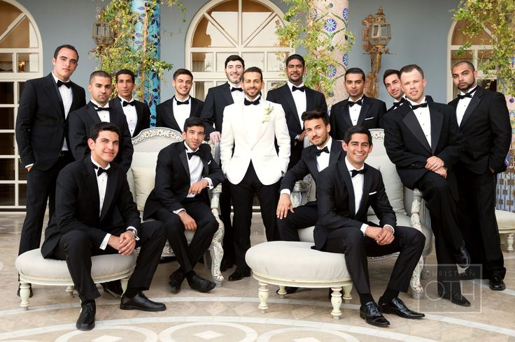 Black tuxes with the groom in a white dinner jacket. Love it. [Photography | Christian Oth Studio - christianothstudio.com]