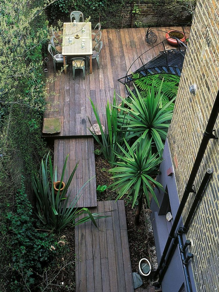 Good-quality materials and different levels create interest in this wonderful garden. A series of rectangles links a narrow section with the main garden, and strikes a balance between plants and decking.