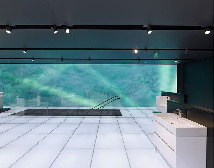 MAD projects simulations of people on LED screens inside roca beijing gallery
