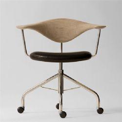Wegner tegnede kontordrejestolen i 1955 til Johannes Hansen Møbelsnedkeri. PP Møbler overtog produktionen i 1991.  Wegner tegnede ikke mange af denne type stole, og samtidig blandes træ og forkromede stålrør i PP 502, hvilket er en materialesammensætning, der ikke ses i mange andre af Wegners modeller. Stolens laveresiddende rygstøtte illustrerer, at Wegner var stærkt optaget af ergonomiske forhold.