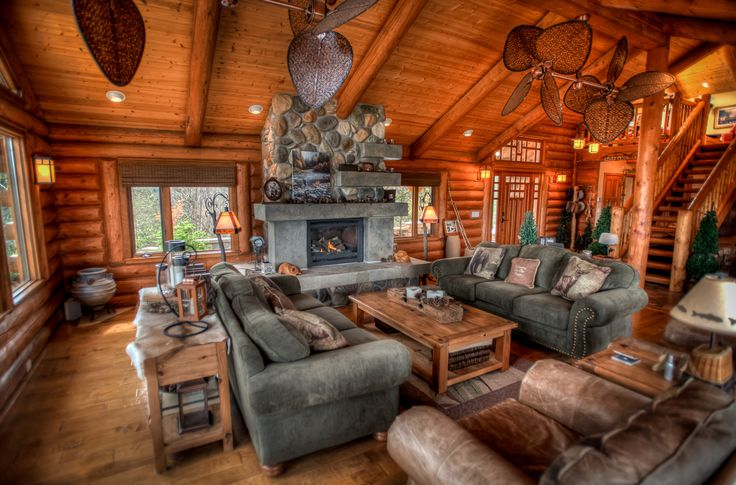 Log Home Living Room, Stone Fireplace, Unique Ceiling Fans