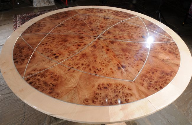 Extended Dining table constructed from rippled Sycamore and Burr Elm veneer. Silver inlay. #SAFF #diningtable #interiordesign #silver