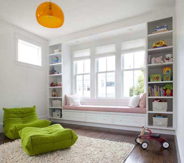 great way to organize a kids corner/room and add a spot for them to relax/read. love the wood floors, soft shag rug and natural light.