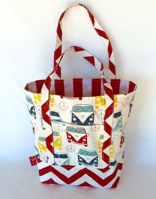Although they're advertised as tote bags, these super funky Kombi bags by Ruby's Quilts & More would make great storage for small toys or rolled up wraps in a transport themed room.