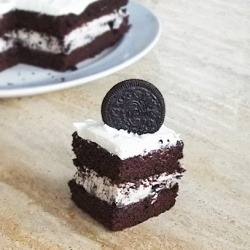 A rich, fudgy chocolate cake with a cheesecake-like Oreo filling and an Oreo-creme frosting.  Delicious insanity. (eggless)