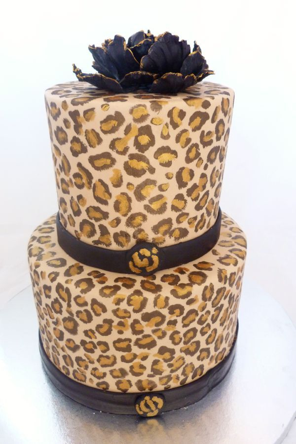 2 Tier Handpainted Cheetah Print cake, cheetah print on the inside of cake, too.  Covered in fondant and finished with a black sugar flower.